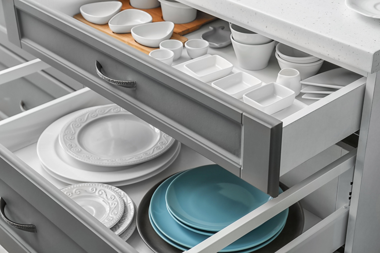 Set of tableware in kitchen drawers | Pierce Flooring