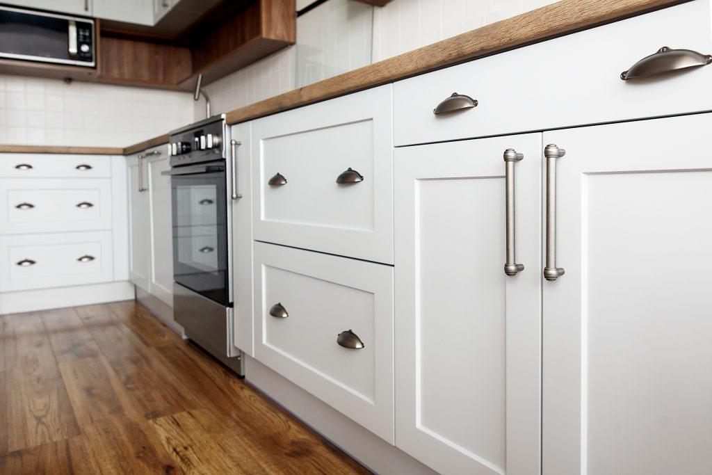 Stylish light gray handles on cabinets | Pierce Flooring